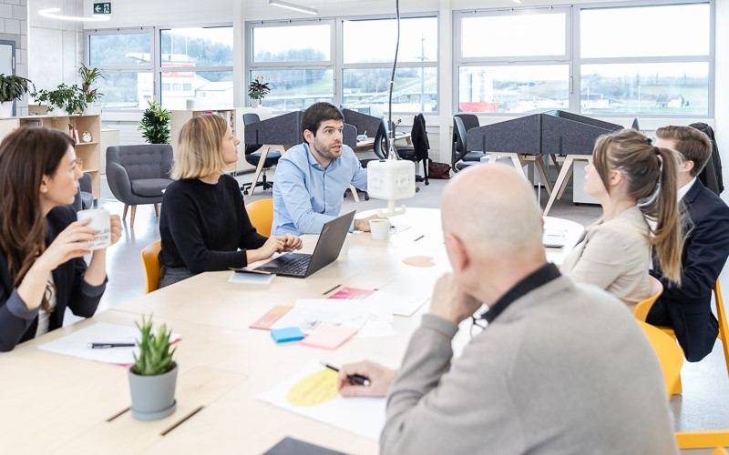 Business people at the Switzerland Innovation Park Basel Area site Jura